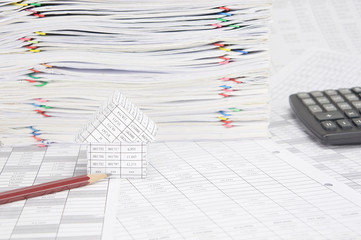 Pencil and house on finance account