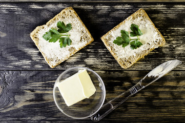 Sandwich with butter and a knife.