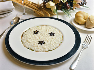 White risotto with chocolate starlets