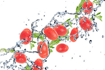 Foto op Aluminium Opspattend water salad with tomatoes isolated on white background and Splashing water