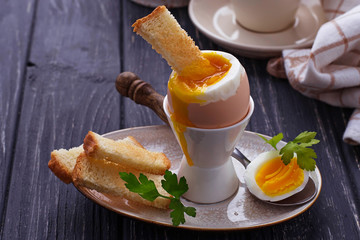 Soft-boiled egg and toasts