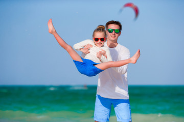 Happy family having fun during tropical beach vacation