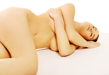 Naked woman sleeping on the floor
