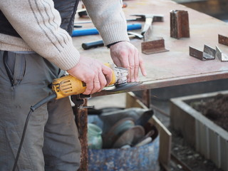 Builder with Bulgarian Tool