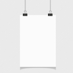 Blank white page hanging against grey background