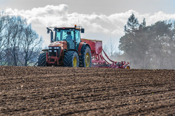 Wall Mural - Tractor harrowing the field