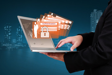 Businessman showing concept of business online security on virtu
