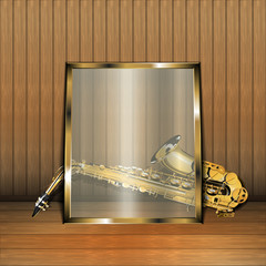 saxophone on wooden background under glass