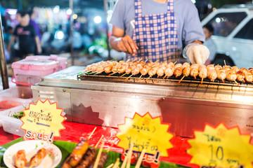 Grilled sausage in market