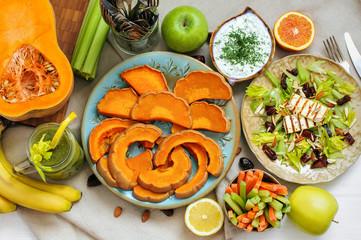 Healthy lunch salad, tzatziki and baked pumpkin