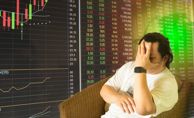 Stock market chart with stress man / Long hair stress man sitting in chair hold head with hand with Stock market chart and data board as background