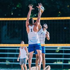 Beach volleyball men's game, blocking spike