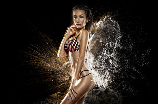 Sexy girl in water splash