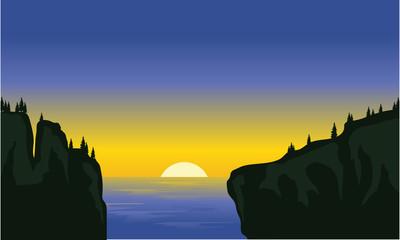 Silhouette of cliff in the sea