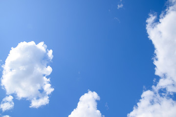 Bright midday blue sky with clouds