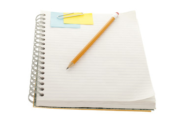 notebook with adhesive note, paper clip and pencil