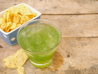 glass of apple juice and potato chips
