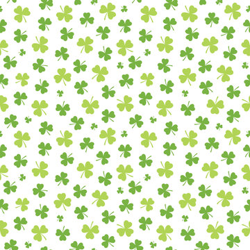 Seamless Irish background pattern for St Patrick's Day with shamrocks in green and white. St Patrick's Day, giftwrap, wallpaper, textiles.