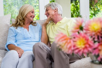 Romantic senior couple sitting in living room