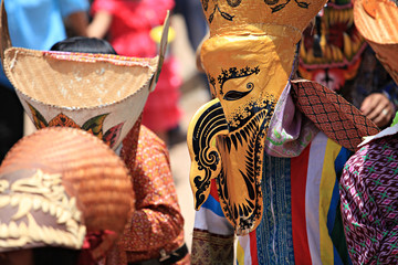 Phi Ta Khon Festival in Loei, Thailand. Young people dress in spirit and wear a mask, sing and dance