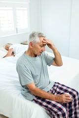 Senior man suffering from headache at home