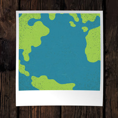 Photo frame with Earth snapshot closeup. Earth day concept. With