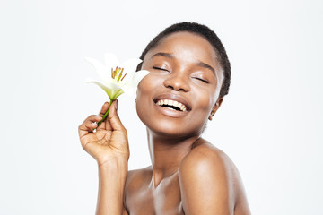 Smiling afro american woman holding flower