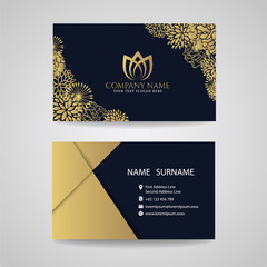 Business card - gold floral frame and lotus logo and gold paper on dark blue background