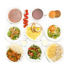 Top view of many plates with food