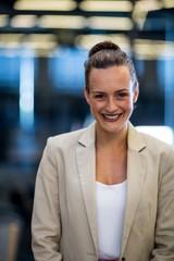 Confident businesswoman smiling at camera