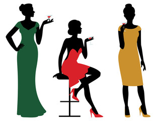 Silhouettes of women dressed in evening dress holding wine glass