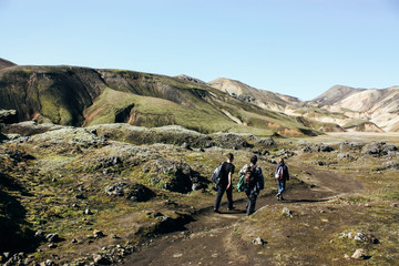 Icelandic landscape with tourists. Beautiful mountains and volca