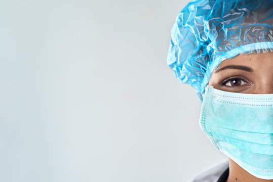 Happy female surgeon in mask with copy space
