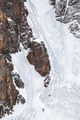 Ice climbing on wall in Tian Shan mountains