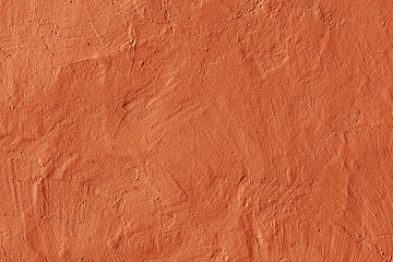 Abstract orange plaster wall texture.