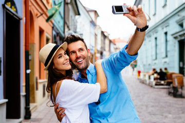 tourists couple taking selfie on city street