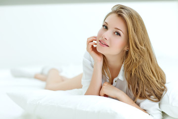 Portrait of a beautiful woman in the morning bed