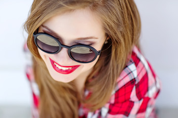 portrait of a beautiful woman in sunglasses