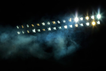 Stadium lights against dark night sky