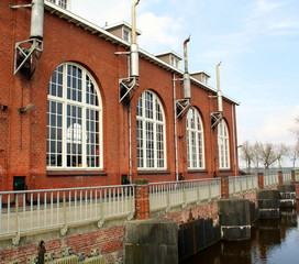 "Pumping station ""De Waterwolf"" with exhaust pipes from 1920 at Lammerburen. The Netherlands"