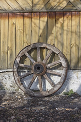 wood wheel near wall.