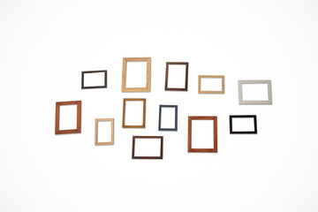 Group photo frames on the wall inside room