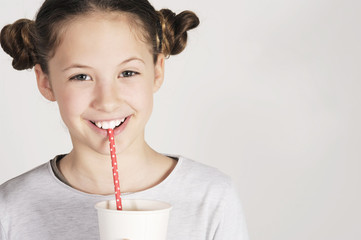 cute funny girl drinking with dotted straw, happy kid in retro style