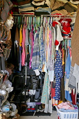 Messy Closet Filled with Woman's CLothes