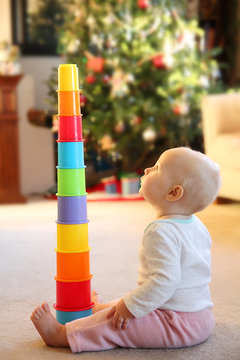 Baby Girl Playing with Stacking Cup Toy