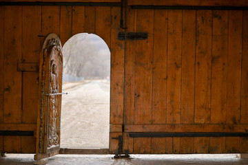 Open wooden door of outside wall and bokeh