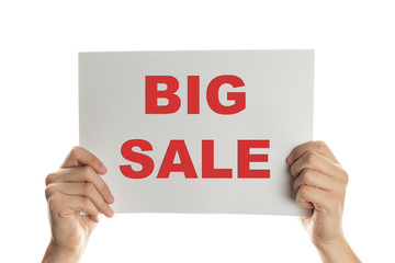 Hand holding a banner with the words big sale