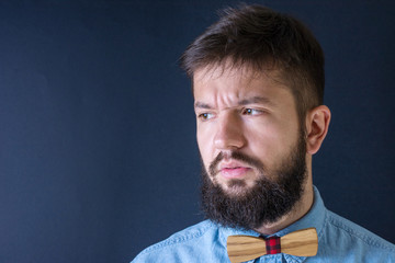 Angry bearded man in a blue shirt