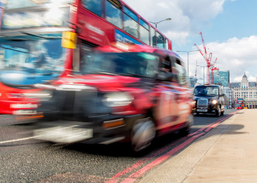 London Transport Concept. Red Bus And Black Taxi Cab Motion Blur