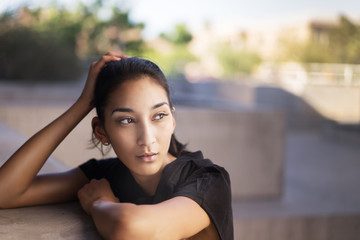 Young woman in contemplative mood looking to side